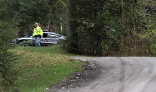 Police appears at roadblock on Doc's Drive , Friday, April 27, 2012 in Grantham, N.H.  James Perriello has been charged with second-degree murder for fatally shooting his wife, Natalie Periello, inside their home Thursday night, with their four children present. (AP Photo/Jim Cole)