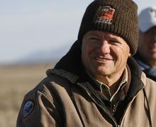 Rick Egan  | The Salt Lake Tribune   Utah DWR biologist Guy Wallace observes the Gunnison sage grouse at sunrise as they strut on a lek near Monticello, Utah, March 31, 2012.