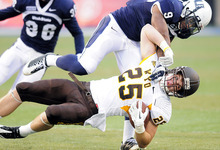 Utah State linebacker Bobby Wagner (9) tackles Wyoming tight end Spencer Bruce during their NCAA college football game on Saturday, Oct. 8, 2011, in Logan. (AP Photo/The Herald Journal, Eli Lucero)