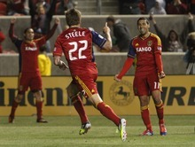 Rick Egan  | The Salt Lake Tribune   Real Salt Lake's Jonny Steele (22)  and Real Salt Lake's Javier Morales (11) Real  celebrate after Salt Lake went up 3-2 in the final minutes of the game,  in RSL action, Real Salt Lake vs. Toronto FC, in Salt Lake City, Saturday, April 28, 2012.