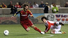 Rick Egan  | The Salt Lake Tribune   Real Salt Lake's Kyle Beckerman (5)  is tripped up, in RSL action, Real Salt Lake vs. Toronto FC, in Salt Lake City, Saturday, April 28, 2012.