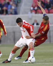 Rick Egan  | The Salt Lake Tribune   Real Salt Lake's Alvaro Saborio (15)  goes after the ball along with Miguel Aceval, Toronto FC, in RSL action, Real Salt Lake vs.Toronto FC,  in Salt Lake City, Saturday, April 28, 2012.