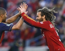 Rick Egan  | The Salt Lake Tribune   Real Salt Lake's Kyle Beckerman (5)  celebrates with Real Real Salt Lake's Alvaro Saborio (15) after scoring Salt Lake's first goal of the night, early in the first period, Saturday, April 28, 2012.
