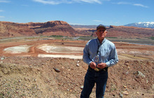 Judy Fahys | Tribune file photo Atlas tailings project manager Don Metzler, with the Department of Energy, stands in front of the site near Moab where millions of tons of uranium waste have been removed. A new contract went to an Idaho company to take over from EnergySolutions Inc. and Rep. Jim Matheson said he is concerned that a scale-back in funding will slow down the project.