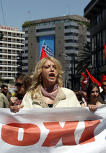 A protester hold a banner reading ''No'' during a May Day protest in Athens, Tuesday, May 1, 2012.  In debt-crippled Greece, more than 2,000 people marched through central Athens in subdued May Day protests centered on the country's harsh austerity program.(AP Photo/Thanassis Stavrakis)