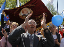 Members of Belarusian Federation of trade unions applaud during a rally to mark May Day in Minsk, Tuesday, May 1, 2012. (AP Photo/Sergei Grits)