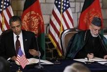 President Barack Obama and Afghan President Hamid Karzai sign a strategic partnership agreement at the presidential palace in Kabul, Afghanistan, Wednesday, May 2, 2012. (AP Photo/Charles Dharapak)