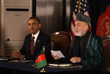 President Barack Obama and Afghan President Hamid Karzai speak before signing a strategic partnership agreement at the presidential palace in Kabul, Afghanistan, Wednesday, May 2, 2012. (AP Photo/Charles Dharapak)