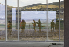 Trent Nelson  |  The Salt Lake Tribune Photographers reflected in a window during a tour of the construction of the first phase of Adobe's new campus Tuesday, May 1, 2012 in Lehi, Utah. The 280,000 square-foot building is set to be completed in late 2012.