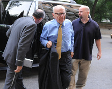 Louis Lanzano  |  The Associated Press News Corporation head Rupert Murdoch arrives at his Fifth Avenue residence, Wednesday, July 20, 2011, in New York. Emerging relatively unscathed from a British parliamentary hearing on the phone hacking scandal, Rupert Murdoch returned to the United States on Wednesday, where his company faces a host of financial and legal challenges.