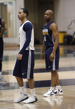 Francisco Kjolseth  |  The Salt Lake Tribune Utah point guard Devin Harris, left, and Jamaal Tinsley join the team for practice on Tuesday, May 1, 2012 as the Utah Jazz get ready for round two of the playoffs against San Antonio at the Zions Bank Basketball Center. Much of their work hinders on their ability to defend Tony Parker of the Spurs.