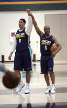 Francisco Kjolseth  |  The Salt Lake Tribune Utah Jazz guard Jamaal Tinsley, right, has a little fun with teammate Enes Kanter prior to practice on Tuesday, May 2, 2012, at the Zions Bank Basketball Center. The Utah Jazz are getting ready for round two of the playoffs against San Antonio with much of their work hindering on their ability to defend Tony Parker of the Spurs.