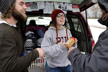 Trent Nelson  |  The Salt Lake Tribune Buddy Tymczyszyn, left, and Kimberly Bell, of Volunteers of America, give food and other items to a homeless man named Cliff while working on Utah's annual statewide Point-in-Time homeless count in Salt Lake City on Thursday, Jan. 26, 2012.