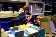 Trent Nelson  |  The Salt Lake Tribune Kimberly Bell, of Volunteers of America, loads up on supplies before heading out to work on Utah's annual statewide Point-in-Time homeless count in Salt Lake City on Thursday, Jan. 26, 2012.