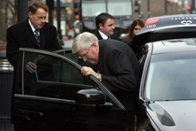 Steve Griffin  |  Tribune file photo Dewey C. MacKay lowers himself into a car waiting outside the Frank E. Moss U.S. Courthouse in Salt Lake City in December 2011 following his sentencing on charges related to prescribing more than 1.9 million hydrocodone pills and nearly 1.6 million oxycodone pills between June 1, 2005, and Oct. 30, 2009. His attorney Peter Stirba is at left.