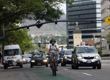 Kim Raff | The Salt Lake Tribune A person rides a bicycle down 200 South in downtown Salt Lake City, Utah on April 30, 2012.