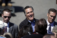 Republican presidential candidate, former Massachusetts Gov. Mitt Romney greets supporters at the Portsmouth Fish Pier in Portsmouth, N.H., Monday, April 30, 2012. (AP Photo/Jae C. Hong)