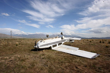 Steve Griffin  |  The Salt Lake Tribune  A plane crashed Tuesday near Elberta. The pilot and passenger both survived the crash.