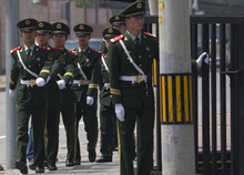 Chinese paramilitary police patrol outside the U.S. Embassy in Beijing, China, Wednesday, May 2, 2012. Secretary of State Hillary Rodham Clinton arrived Wednesday in Beijing, where a tense human rights showdown awaits over the fate of a blind Chinese lawyer said to be under U.S. protection after escaping from house arrest. (AP Photo/Alexander F. Yuan)