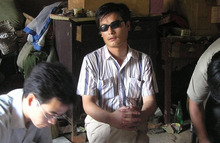 FILE - In this undated photo released by supporters of Chen Guangcheng, blind activist Chen Guangcheng, center, is seen in a village in China.  Guangcheng says a U.S. official told him that Chinese authorities threatened to beat his wife to death had be not left the American Embassy. Speaking by phone from his hospital room in Beijing on Wednesday, May 2, 2012, a shaken Chen told The Associated Press that U.S. officials relayed the threat from the Chinese side. Chen, who fled to the embassy six day ago, left under an agreement in which he would receive medical care, be reunited with his family and allowed to attend university in a safe place. He says he now fears for his safety and wants to leave. (AP Photo/Supporters of Chen Guangcheng, HO)