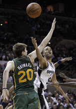 San Antonio Spurs' Tony Parker, right, shoots against Utah Jazz's Gordon Hayward (20) during the third quarter of Game 2 of a first-round NBA basketball playoff series, Wednesday, May 2, 2012, in San Antonio. (AP Photo/Eric Gay)