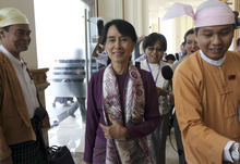 Myanmar pro-democracy icon Aung San Suu Kyi, center, arrives at parliament to attend a regular session of Myanmar Lower House in Naypyitaw, Myanmar, Wednesday, May 2, 2012. (AP Photo/Khin Maung Win)