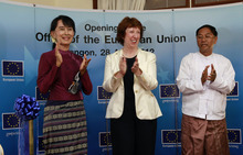 In this photo taken Saturday, April 28, 2012, from left, Myanmar pro-democracy leader Aung San Suu Kyi, EU foreign policy chief Catherine Ashton and Yangon Divisional Minister Myint Swe, clap hands during the opening ceremony of the office of the European Union in Yangon, Myanmar. The European Union said it will work toward establishing a full diplomatic mission in Myanmar. (AP Photo/Khin Maung Win)