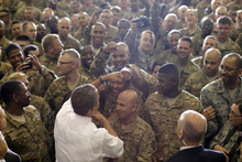 President Barack Obama fist bumps service members after he addressed troops at Bagram Air Field, Afghanistan, Wednesday, May 2, 2012. (AP Photo/Charles Dharapak)