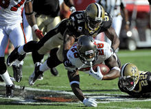 This Oct. 16, 2011 file photo shows New Orleans Saints linebacker Jonathan Vilma (51) taking down Tampa Bay Buccaneers running back Kregg Lumpkin (28) during the second quarter of an NFL football game, in Tampa, Fla. Vilma has been suspended without pay for the entire 2012 season by the NFL, one of four players punished for participating in a pay-for-pain bounty system. NFL Commissioner Roger Goodell's ruling was announced Wednesday, May 2, 2012 . (AP Photo/Brian Blanco, File)
