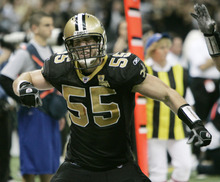 This Jan. 13, 2007 file photo shows New Orleans Saints linebacker Scott Fujita reacting after his team made a play against the Philadelphia Eagles during the NFC divisional playoff football game in New Orleans. Saints linebacker Jonathan Vilma has been suspended without pay for the entire 2012 season by the NFL, one of four players punished for participating in a pay-for-pain bounty system. Defensive lineman Anthony Hargrove, now with the Green Bay Packers, is suspended for eight games this season; Saints defensive end Will Smith is barred for four games; and linebacker Scott Fujita, now with the Cleveland Browns, will miss three games. All of the suspensions are without pay. (AP Photo/Rogelio V. Solis, File)
