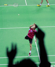 Shon Wan-ho of South Korea throws his racquet to the spectators after winning over world's No. 1, Lee Chong Wei of Malaysia, in the men's singles final at the India Open badminton tournament in New Delhi, India, Sunday, April 29, 2012. (AP Photo/ Saurabh Das)