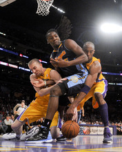 Los Angeles Lakers' Steve Blake, left, and Kobe Bryant,right, battles Denver Nuggets' Kenneth Faried for a loose ball during the second half of a NBA first-round playoff basketball game in Los Angeles, Tuesday, May 1, 2012. The Lakers won 104-100. (AP Photo/Chris Carlson)