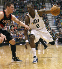 Chris Detrick  |  The Salt Lake Tribune Utah Jazz small forward Josh Howard (8) runs around Portland Trail Blazers small forward Luke Babbitt (8) during the fourth quarter of the game at EnergySolutions Arena Thursday April 26, 2012. The Jazz won the game 96-94.