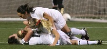 Steve Griffin  |  The Salt Lake Tribune   Alta's senior Michelle Murphy, bottom, is mobbed by her teammates after scoring the only goal during the girl's 5A championship soccer game between Alta and Viewmont at Rio Tinto Stadium in Sandy, Utah Friday, October 21, 2011.