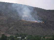 Courtesy UtahFireInfo via Twitter Firefighters on Wednesday are battling a 500-acre blaze near the southwestern Utah town of Toquerville. The wildfire, burning in Bureau of Land Management acreage containing cheat grass, brush, pinyon and juniper trees, was about 30 percent contained as of Wednesday.