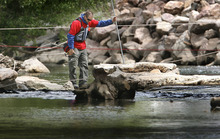 Scott Sommerdorf  |  Tribune file photo              A search and rescue worker pauses while searching an area near the Exchange Street bridge in Ogden on Monday.