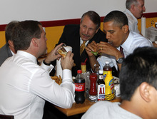 FILE - In this June 24, 2010 file photo, President Barack Obama and Russia's President Dmitry Medvedev, left, eat burgers at Ray's Hell Burger in Arlington, Va. Call it the Obama effect: a presidential visit can be good advertising for the restaurants and businesses. Interest in where and what Obama and his family does can be explained with one word: authenticity. (AP Photo/Charles Dharapak, File)