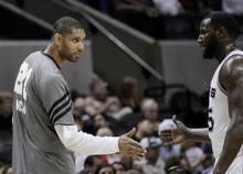 San Antonio Spurs' Tim Duncan, left, greets teammate DeJuan Blair, right, during the fourth quarter of Game 2 of a first-round NBA basketball playoff series against the Utah Jazz, Wednesday, May 2, 2012, in San Antonio. San Antonio won 114-83. (AP Photo/Eric Gay)