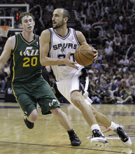 San Antonio Spurs' Manu Ginobili, right, of Argentina, drives past Utah Jazz's Gordon Hayward during the third quarter of Game 2 of a first-round NBA basketball playoff series, Wednesday, May 2, 2012, in San Antonio. San Antonio won 114-83. (AP Photo/Eric Gay)