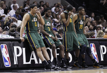 Utah Jazz's Enes Kanter (0), DeMarre Carroll (3), Alec Burks (10) and Derrick Favors (15) wait on the sideline during a timeout in the fourth quarter of Game 2 of a first-round NBA basketball playoff series against the San Antonio Spurs, Wednesday, May 2, 2012, in San Antonio. San Antonio won 114-83. (AP Photo/Eric Gay)