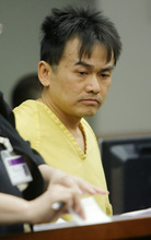Kiet Thanh Ly, Smith's stabbing suspect appears before Judge Katie Bernards-Goodman Thursday, May 3, 2012 in his initial appearance in court at the Scott M Matheson Courthouse in Salt Lake City.