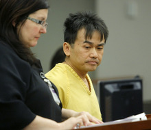 Kiet Thanh Ly, Smith's stabbing suspect stands with Attorney Kimberly A Clark as he appears before Judge Katie Bernards-Goodman Thursday, May 3, 2012 in his initial appearance in court at the Scott M Matheson Courthouse in Salt Lake City.