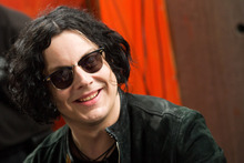 FILE - In this June 24, 2011 file photo, Jack White signs copies of the record he made with Stephen Colbert in New York. The former White Stripe has released his first solo album,