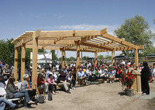 Rick Egan  | The Salt Lake Tribune   Jani Iwamoto speaks at the grand opening of the community garden in Holladay,  Friday, May 4, 2012.  The Mount Olympus Garden is a cooperative venture for Howard R. Driggs Elementary School, Olympus Junior High School, Salt Lake City, Holladay City, Salt Lake County, and New Roots of Utah in partnership with the International Rescue Committee.
