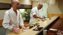 Courtesy of Magnolia Pictures Jiro Ono, left, and his son, Yoshikazu, prepare dinner for patrons, in a scene from the documentary