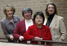 Linda Hamilton, center left, transition director, Salt Lake City libraries and Karen Okabe, center right, deputy transition director.  Ryan Galbraith/photograph 12.20.05