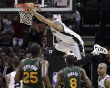 San Antonio Spurs' Danny Green hangs on the rim after he scored against the Utah Jazz during the first quarter of Game 2 of a first-round NBA basketball playoff series, Wednesday, May 2, 2012, in San Antonio. (AP Photo/Eric Gay)