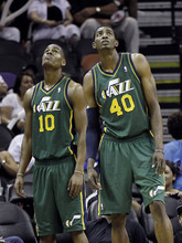 Utah Jazz's Alec Burks (10) and Jeremy Evans (40) look at the scoreboard during the final moments of Game 2 of a first-round NBA basketball playoff series against the San Antonio Spurs, Wednesday, May 2, 2012, in San Antonio. San Antonio won 114-83. (AP Photo/Eric Gay)