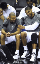 Billy Calzada / San Antonio Express-News  Tony Parker, left, and Tim Duncan of the Spurs enjoy themselves on the bench during their 114-83 victory over the Utah Jazz in NBA playoffs action at the AT&T Center on Wednesday, May 2, 2012.