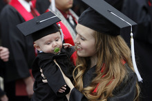 Francisco Kjolseth  |  The Salt Lake Tribune Camille Larsen holds her son Charlie, 4 months, as they celebrate her degree at the University of Utah annual commencement ceremonies at the Huntsman Center in Salt Lake City on Friday, May 4, 2012.